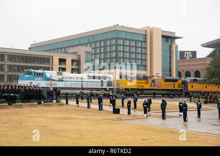Train carrying the casket of former President George H.W. Bush from Houston arrives at Texas A&M University in College Station for burial at the nearby George Bush Library. - Stock Photo