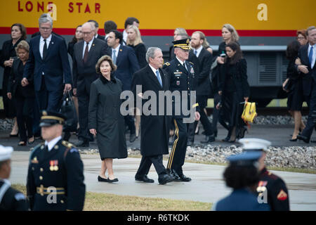 Former Pres. George W. Bush and wife Laura arrive at Texas A&M University with the train carrying the casket of Bush's father, former President George H.W. Bush, before burial at the nearby George Bush Library. - Stock Photo
