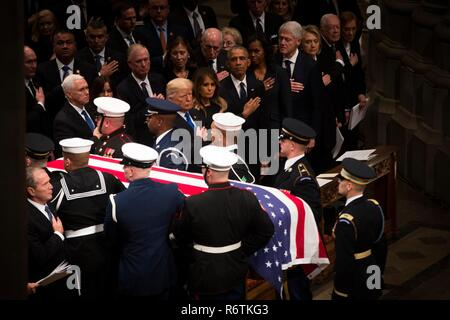 U.S. President Donald Trump and First Lady Melania Trump join former presidents and first ladies as the flag draped casket of former president George H.W. Bush is carried down the aisle of the National Cathedral at the conclusion of the State Funeral December 5, 2018 in Washington, DC. Standing from left to right are: President Donald Trump, First Lady Melania Trump, President Barack Obama, First Lady Michelle Obama, President Bill Clinton, First Lady Hillary Clinton, President Jimmy Carter and First Lady Rosalynn Carter.  Bush, the 41st President, died in his Houston home at age 94. - Stock Photo