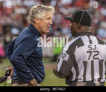 San Francisco, California, USA. 18th Oct, 2012. Seahawks head coach Pete Carroll talks to side judge on Thursday at Candlestick Park in San Francisco, CA. The 49ers defeated the Seahawks 13-6. Credit: Al Golub/ZUMA Wire/Alamy Live News - Stock Photo
