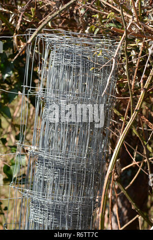 wire mesh fence rolled - Stock Photo