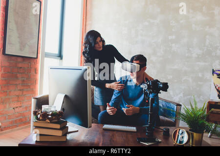 People shooting on special camera wearing vr headset. video producer, creation of virtual content, computer, glasses. - Stock Photo