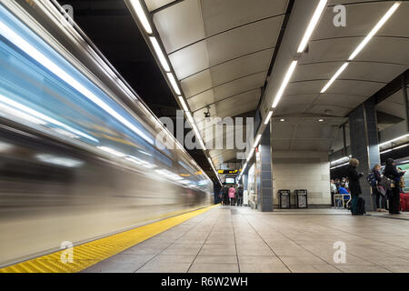 VANCOUVER, BC, CANADA - OCT 3, 2018: A time lapse Vancouver City Center station at evening rush hour with people embarking and disembarking the train  - Stock Photo