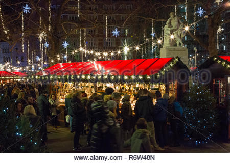 London, UK - December 2: people visiting the Christmas Market in Leicester Square on December 2, 2018 in London, UK - Stock Photo
