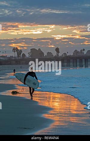 Beach sunrise and surf at California beach - Stock Photo