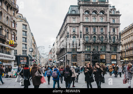 Vienna, Austria - November 24, 2018: People walking on Stephansplatz, a famous square in Vienna named after its most prominent building, the Stephansd - Stock Photo