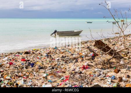 Garbage dump, landfill on Micronesian atoll sandy beach, South Tarawa, Kiribati, Oceania, South Pacific Ocean. Ecological, warming, garbage problems. - Stock Photo