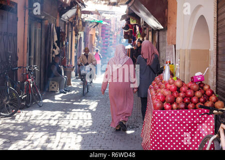 Marrakech Medina - street scene with food for sale and local people, Marrakech Medina, Marrakesh, Morocco north Africa
