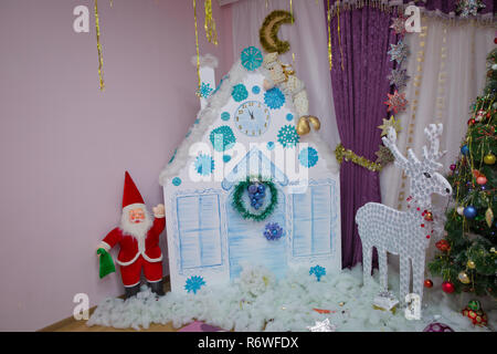 New Year background to take photo . Winter holiday concept, decorated Christmas tree in the interior of photography . House, Dog, curtain - Stock Photo