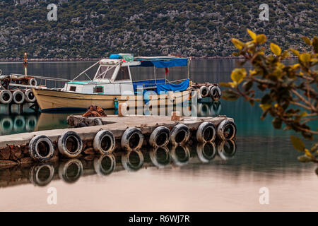 Boat in small fishers village - Stock Photo