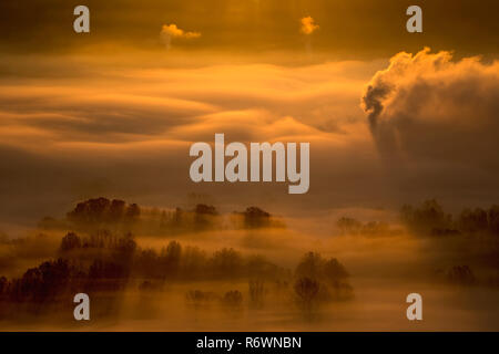 Sunrise on the foggy forest, autumn landscape in Italy - Stock Photo