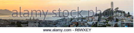 Sunset panoramic views of Telegraph Hill and North Beach neighborhoods with San Francisco Bay, Alcatraz and Angel Islands as well as Marin Headlands. - Stock Photo