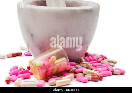 Pink pills and marble mortar - Stock Photo
