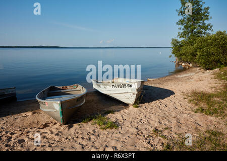 Two small fishing boats on the beach of Manistique Lake in Michigan's upper peninsual - Stock Photo