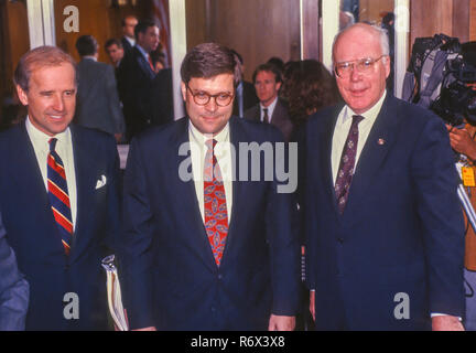 WASHINGTON, DC, USA - NOVEMBER 12, 1991:  William Barr, nominee for U.S. Attorney General, center, Senate Judiciary Committee confirmation hearing. Left Senator Joseph Biden. Right, Senator Patrick Leahy. - Stock Photo