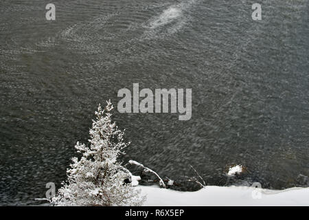 Open water and snow on Junction Creek in winter, Greater Sudbury, Ontario, Canada - Stock Photo