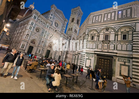 Horizontal streetview of the Duomo di Firenze and Battistero di San Giovanni at night in Florence, Italy. - Stock Photo