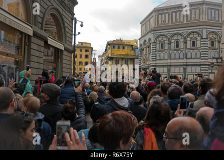 Horizontal view of crowds watching the Easter festival in Florence, Italy. - Stock Photo