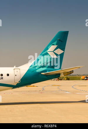 Tali fin of an Air Dolomiti Embraer passenger jet - Stock Photo