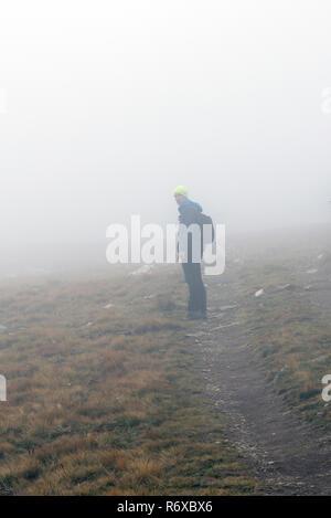 Man hiking on the mountain - Stock Photo