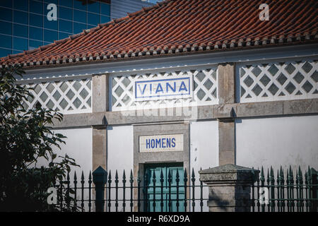 Viana do Castelo, Portugal - May 10, 2018: entrance of the men's toilet in the train station of the city on a spring day - Stock Photo