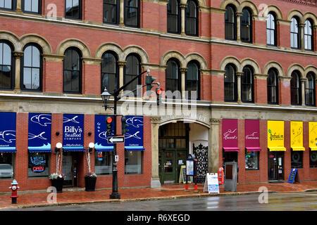 A horizontal view of a brick building that houses the famous Saint John city market - Stock Photo