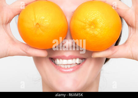 Beautiful girl with juicy orange - Stock Photo