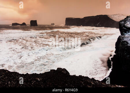 Dyrholaey view during winter which is small peninsula, or promontory located on the south coast village Vik Iceland - Stock Photo