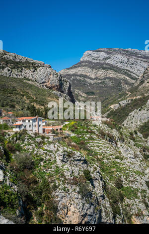 Homes on the cliff in Montenegro - Stock Photo