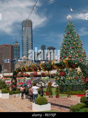 Christmas festivities at Federation Square, with Eureka Tower dominating the Southgate skyline beyond. Melbourne, Australia, December 2018 - Stock Photo