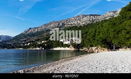 Croatian beach and Adriatic Sea in Brela, Makarska Riviera, Dalmatia, Croatia - Stock Photo