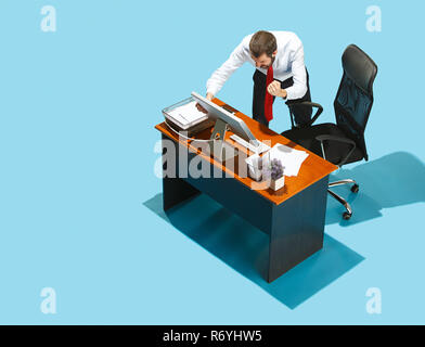 Shot from above of a stylish business man working on a laptop. - Stock Photo