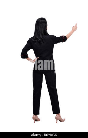 Rear view of asian business woman points finger at something - Stock Photo