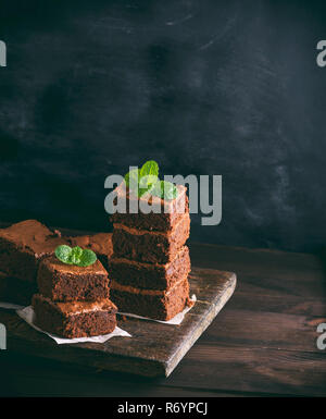 two stacks of square pieces of chocolate baked brownie pie - Stock Photo