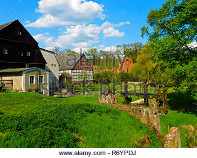 the monastery mill with the ruins of the cistercian monastery - Stock Photo