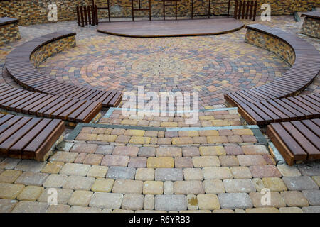 Benches in the park. Sidewalk tile in the park. Infrastructure of leisure in the park - Stock Photo