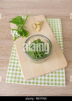 homemade garlic hedge. wild herbs pesto with almonds - Stock Photo