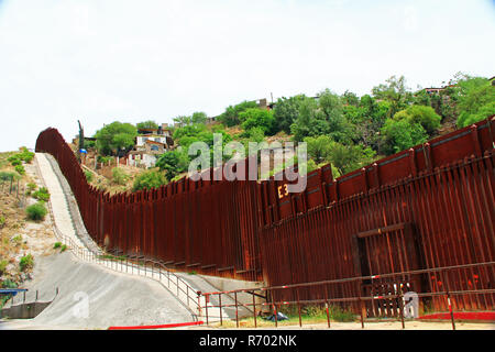 Border Fence Separating the US from Mexico in Nogales, Arizona - Stock Photo