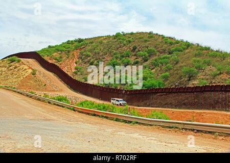 Border Fence Separating the US from Mexico Near Nogales, Arizona - Stock Photo