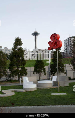 Daytime photo of the Space Needle and modern public art from Victor Steinbrueck Park, WA - Stock Photo
