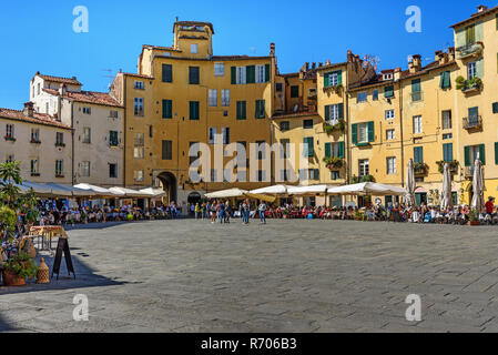 Lucca, Italy - September 25, 2018: Amphitheater Square or Piazza dell'Anfiteatro in center of city - Stock Photo