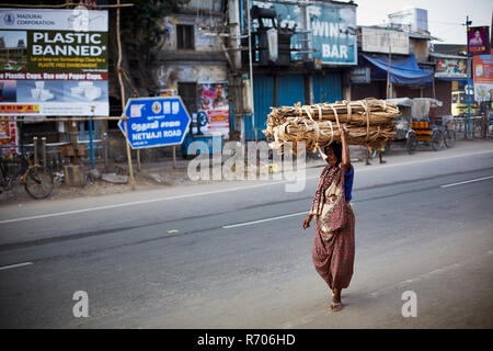 Morning street scene in Madurai near Meenakshi temple - Stock Photo
