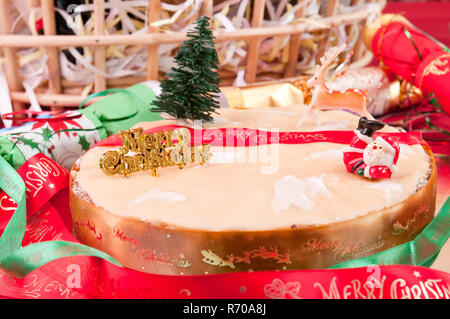 Traditional Christmas cake with gift basket at the background - Stock Photo