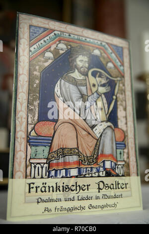 Lichtenau, Germany. 06th Dec, 2018. The Church Dialect Songbook 'Franconian Psalter - Psalms and Songs in Dialect - As fränggische Gsangsbuch' is in the Trinity Church. The special hymnbook for Franconia contains not only the Franconian 'Our Father', but a total of 23 biblical psalms and 44 songs on 80 pages. Including dialect versions of well-known Christmas songs. (to dpa-Korr: 'Vadder unser - Franken gets church dialect songbook' from 07.12.2018) Credit: Daniel Karmann/dpa/Alamy Live News - Stock Photo