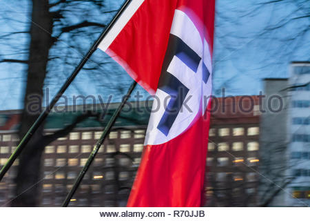 Helsinki, Finland. 6th Dec 2018. Banned Neo Nazi Organisation Nordic Resistance Movement Waving Nazi flags at demonstration on Independecce Day of Finland Credit: Pekka Liukkonen/Alamy Live News - Stock Photo