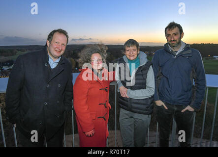 Joachimsthal, Germany. 04th Dec, 2018. David Coleman, (l-r), Ruth Butterfield, Sarah Phillips and Adam Bogud, all British citizens living in Brandenburg, are standing on the viewing platform of the Biorama Project in the evening. Barnim now has a small British colony. Its inhabitants have consciously chosen Brandenburg as their place of residence in the middle of Europe. Nevertheless, they look with concern at the forthcoming Brexit, which encourages them not to return to their old homeland. Credit: Patrick Pleul/dpa-Zentralbild/ZB/dpa/Alamy Live News - Stock Photo