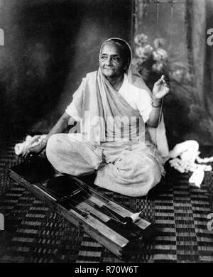 Kasturba Gandhi wife of Mahatma Gandhi spinning wheel, 1940