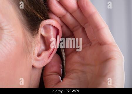 Female Hand On An Ear - Stock Photo