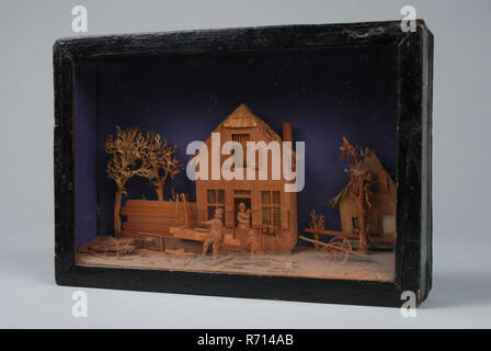 Bavelaar, small viewing box with scene of house with carpenter's workshop, diorama footage wood paint glass paper cardboard, Bavelaar in box of wood cardboard paper and glass. Scene of house with fence and trees in the doorway standing woman with child In front of the house carpenter's workshop: the carpenter is busy planing board his son looks on. On the ground hammer and long planer On the right cart behind it another house. Tree branches and thatched roofs are made of paper; the other parts are cut from red-brown wood with fine grain. Purple paper background probably later affixed optics di - Stock Photo