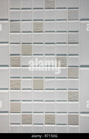 Texture of small squares of mosaic in white and beige ceramic tiles. - Stock Photo